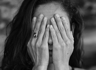 photo-of-woman-covering-her-face-3327126