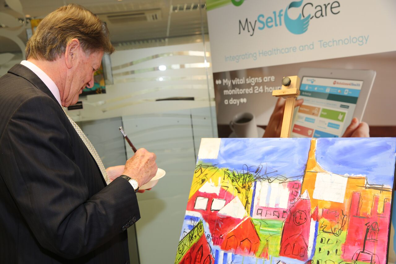 Sir John Madejski paints