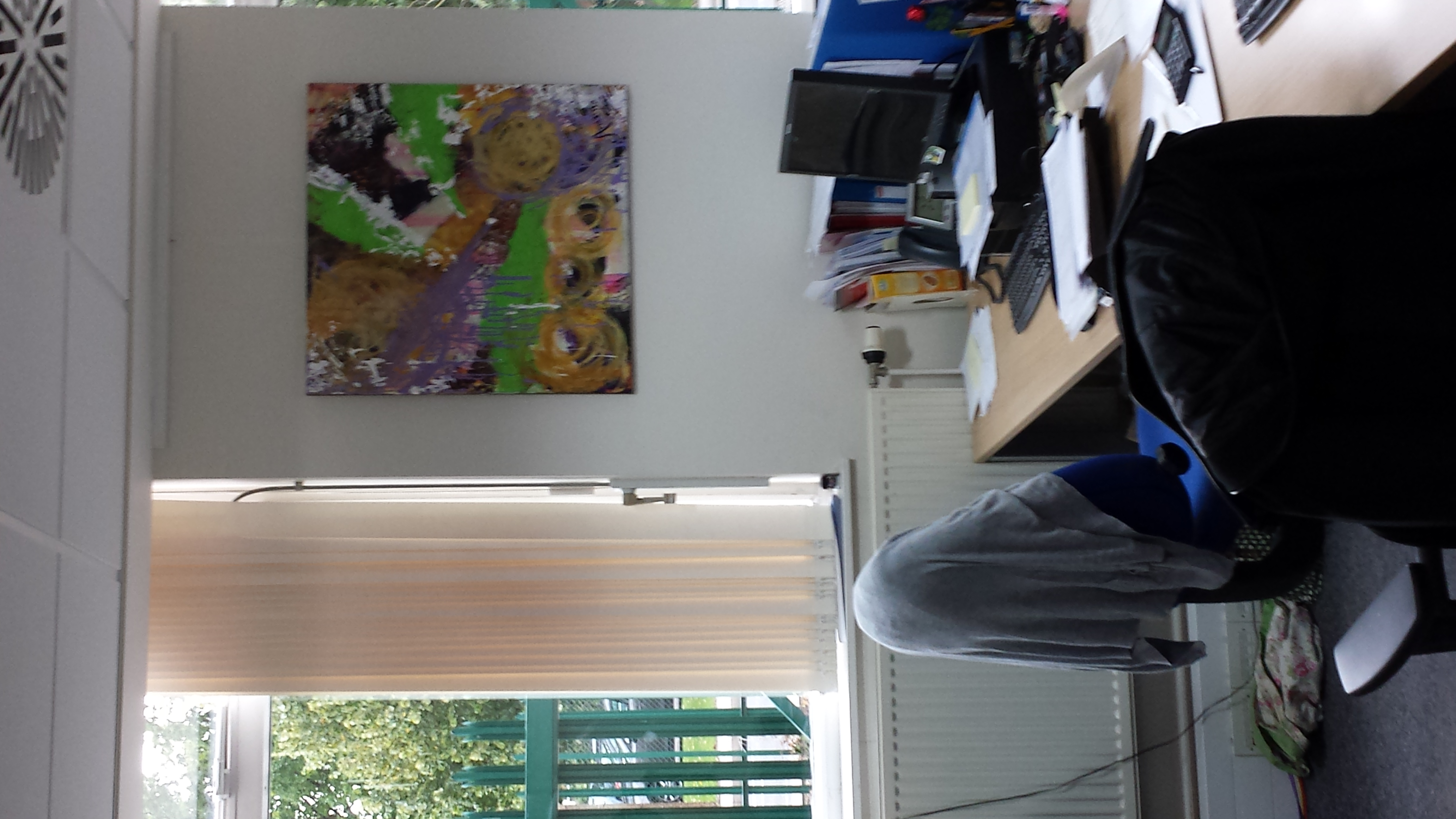 An office with artwork to look at