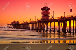 12338568-A-wide-shot-of-the-Huntington-Beach-Pier-during-a-bright-red-and-orange-sunset--Stock-Photo