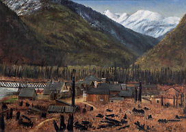 Town of low wooden buildings in brown meadow with train bridge crossing river at left. Logs and blackened trees in foreground. Tree-covered and snowcapped mountains in background beneath sliver of blue sky. Signature and date (15/11/1887) in lower right corner. Gold painted wood frame with thick white linen mat. White label on back for Masters Gallery Ltd.