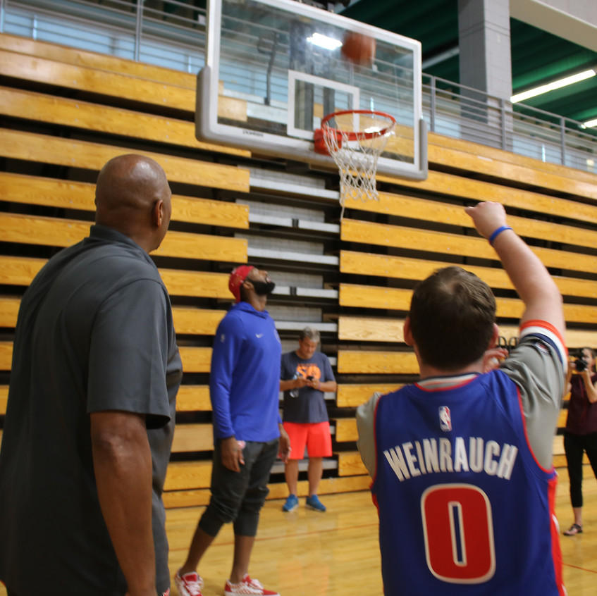 """Earl """"The Twirl"""" leading a shooting drill with a young athlete"""