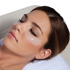 Woman relaxing with gel under eye masks on