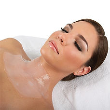 Woman laying down with eyes closed relaxes with gel neck mask on