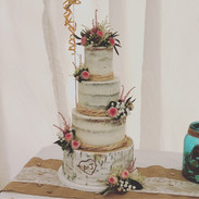 Birch log with semi naked and fresh flowers