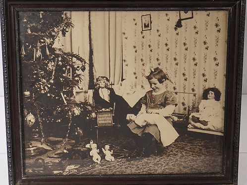 Early 1930s Picture of Child Open Gifts by a Christmas Tree