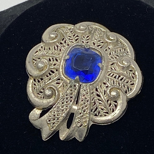 Silver Tone Brooch with Faceted Blue Stone