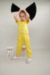 Girl wearing Children's Designer Clothing Brand Indikidual's Banana Print Jumpsuit.