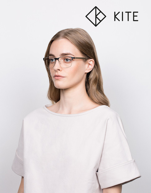 Girl in white shirt wearing glasses by Kite eyewear