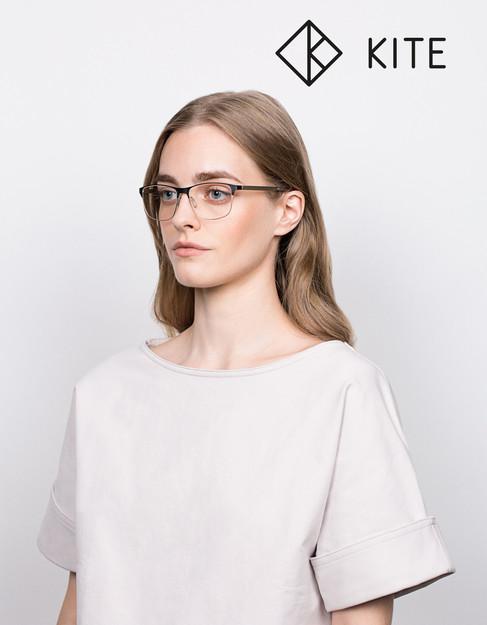 Girl in white shirt wearing glasses by Kite eyewear