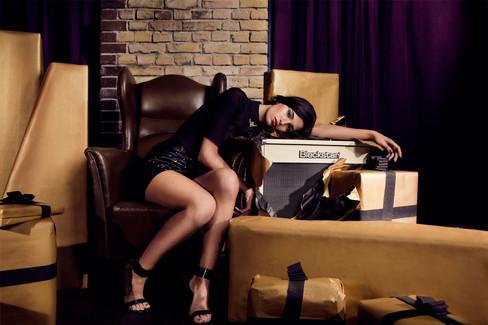 Girl leaning over a blackstar guitar amp advertising the brand