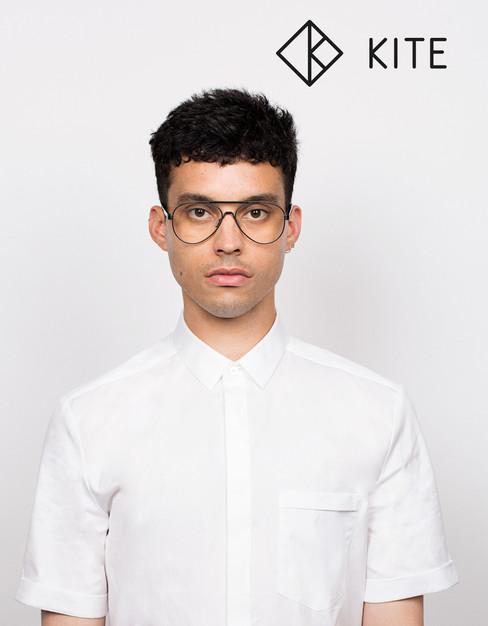 Boy in white shirt wearing glasses by Kite eyewear