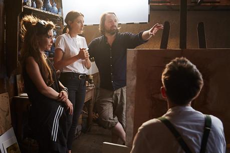 filmmakers julia Schönstädt and matt Rozier on film set discussing