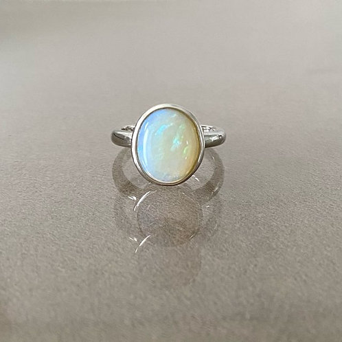 White opal ring set in 925 sterling silver
