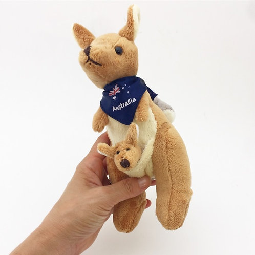 Kangaroo and joey carrying koala soft toy