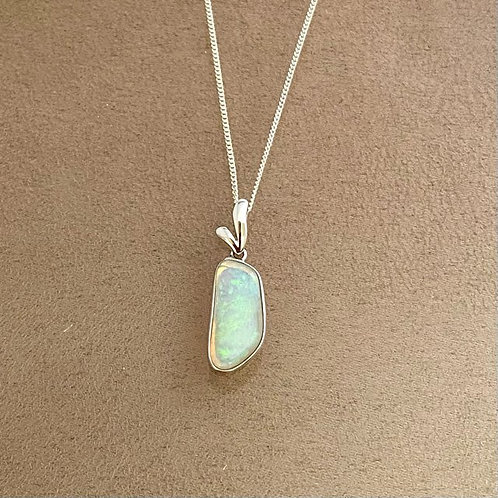 White opal pendant set in 925 sterling silver with 925 silver chain
