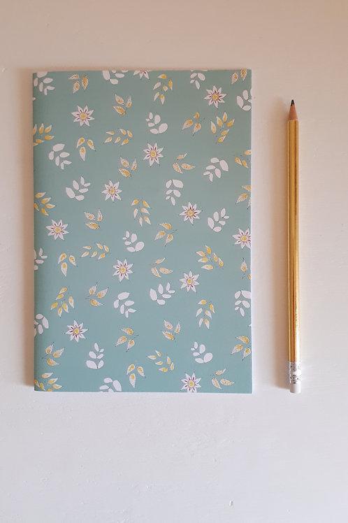 1 cahier fleuri fond bleu vert