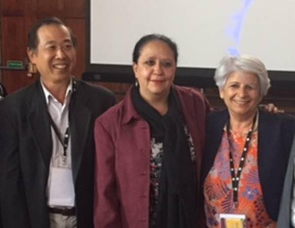 Prof Tan (from left) with the Mexican delegate and IASSW President, Prof Anna Maria Capalini