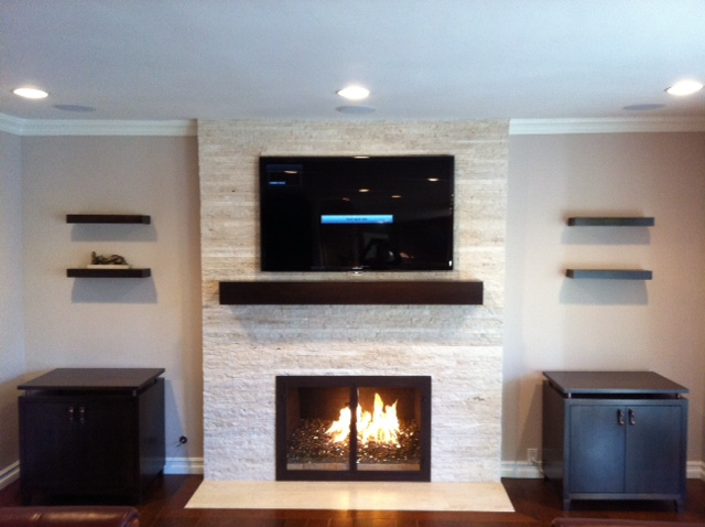 Fireplace & cabinetry completed.