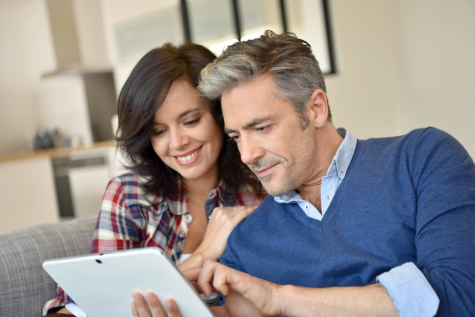 Couple at home websurfing with digital t