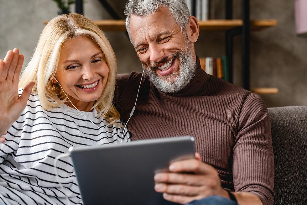 Happy smiling senior couple with digital