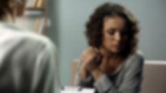 Sad-female-talking-to-her-psychotherapis
