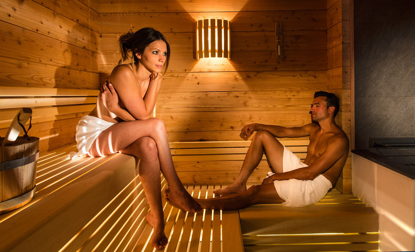 Man and woman in sauna naked