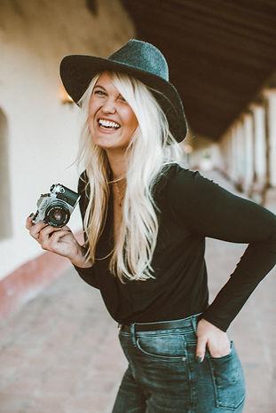 Portrait of Lena Fredrickson holding her Nikon
