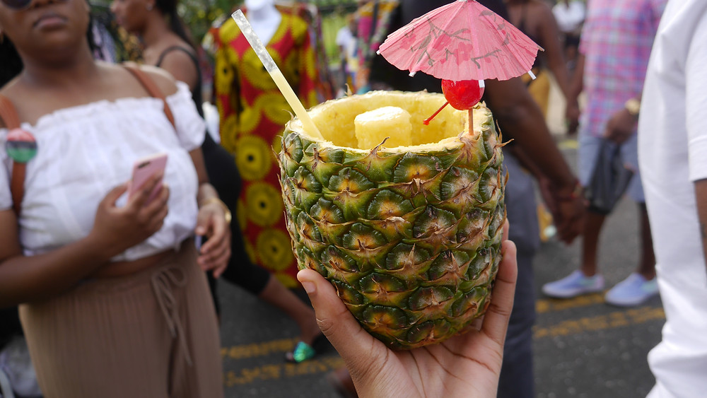 A delicious pineapple drink that is sold by the same vendor every year—they also sell red velvet funnel cakes!