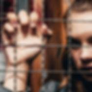 Women Behind Fence.jpg