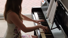 Aletheia Playing The Piano
