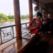 Enjoying a scenic Kerala backwaters cruise