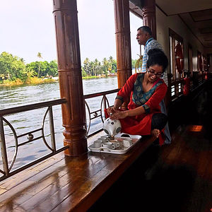 Enjoying a scenic Kerala backwaters cruise
