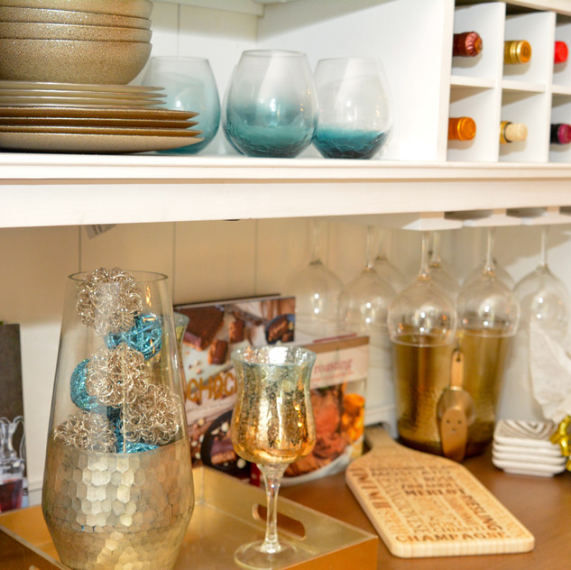Crackle Teal Short Tumblers are from Pier 1 Imports.   In addition, Dinnerware and rattan spheres are all from Pier 1.