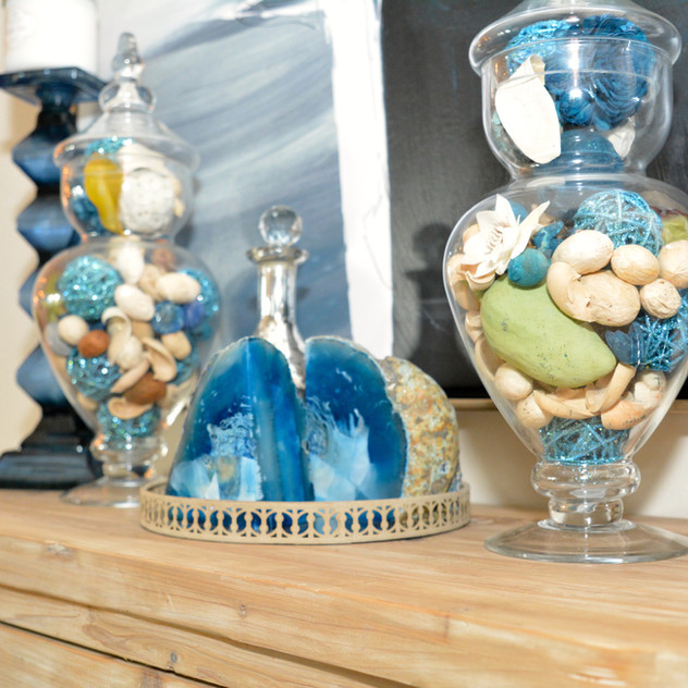 Teal Rattan Spheres inside of both Apothecary Jars are from Pier 1 Imports.  In addition, Blue Candle Holders are from Pier 1.