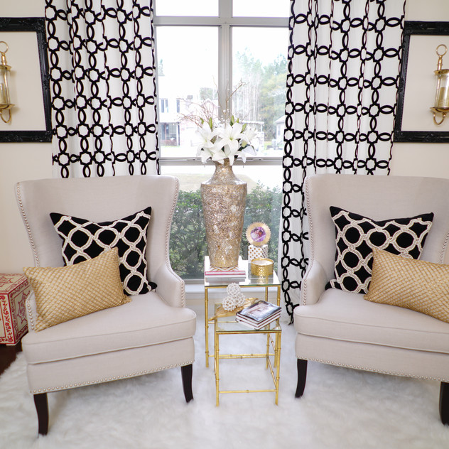 Gold Mosaic Vase and Flocked Geometric Black Grommet Curtain is from Pier 1 Imports.   Also, the Gold Metallic Beads Lumbar Pillow is from Pier 1.