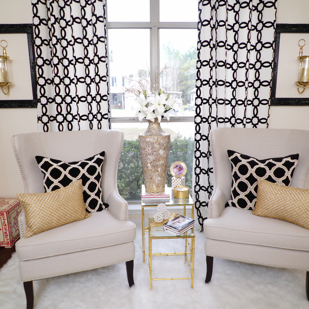 The red and ivory storage boxes on both sides of my wingback chairs are my added pop of color amidst the world of Ivory, Black & Gold in my Home Office. However, I'm contemplating changing up the look with black velvet ottomans instead. Mmmmm...