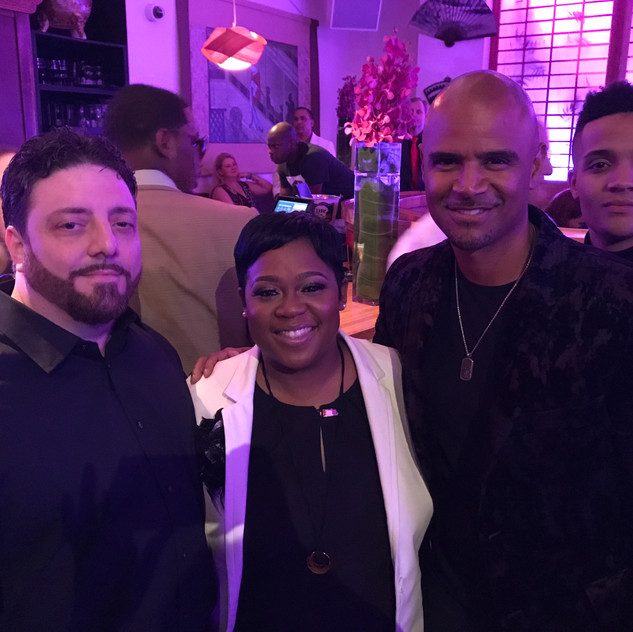 My husband has the perks of accompanying me to many Hollywood parties 😉  L to R - Charlie Piazza, Tachic Hickman-Piazza, Dondre Whitfield and Photobombed by Nicholas Ashe 😂