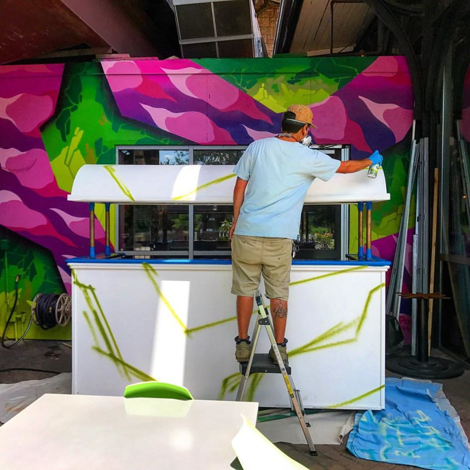 Artist Alex Pock completing a CT Murals project for the Bear's Restaurant Group in Downtown Hartford, CT.