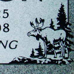 Linear graphic moose on a flashed panel, light grey granite