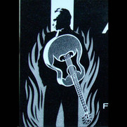 Tri-tone graphic image of Johnny Cash on black granite