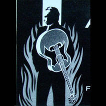Tri-tone graphic image of Johnny Cash on black granite