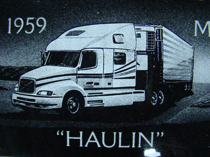 Hand-etched semi truck on black granite