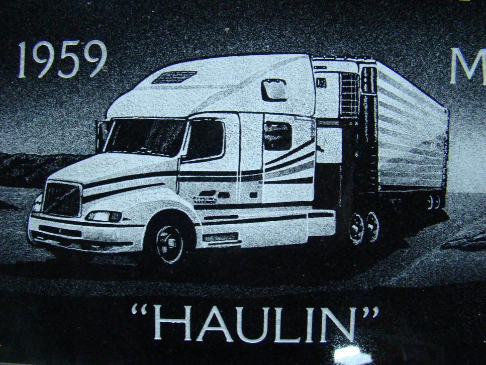 Hand-etched semi truck on black granite
