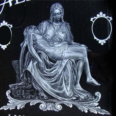 Michaelangelo's La Pieta hand etched on an upright black granite monument