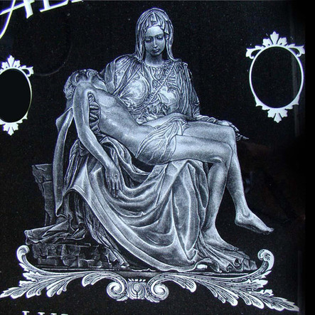Michaelangelo's La Pieta hand etched on an upright black granite monument