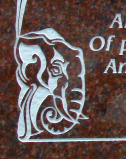 Art Nouveau style border with elephant on Imperial Red granite