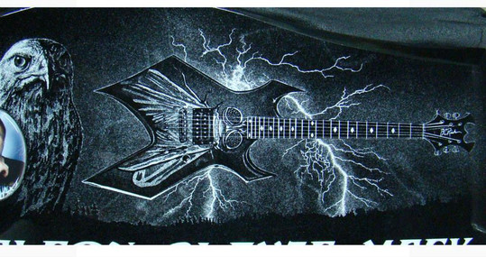 Hand-etched Beast guitar with lightening on black granite