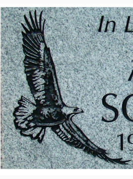 Linear graphic eagle flying on light grey granite
