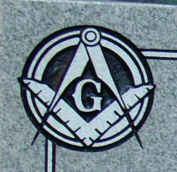 Etched emblem on light grey granite